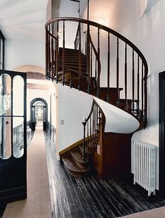 Black floor and stairs, wood rail, white wall.  FleaingFrance Brocante Society Swoon