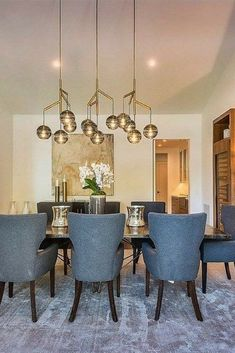 Very cool dining room chairs and pendant lights.