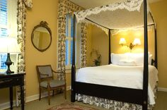 Bed | Luxury accommodations at the 1843 Battery Carriage House Inn located in Charleston, SC.