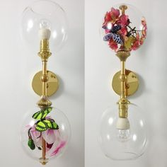 Wall lights with two glass globes - one with a light bulb, one with fake flowers Rothschild and bikers