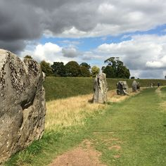 "One of the stone circles within earthwork ""henge"" at Avebury, Wiltshire. Britain has many places of ritual landscape and Avebury is overlooked by many tourists who think only of Stonehenge. Note the bank on left. It plunges into a ditch. This is what a ""henge"" is."