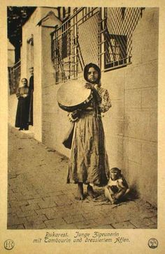 Cyganočka with his tambourine and obez″ânkoj on the streets of Bucharest. Early century postcard from Studii Romani. Notice the monkey Boho Life, Gypsy Life, Gypsy Soul, Frame Drum, Vintage Gypsy, Bucharest, People Of The World, Bohemian Gypsy, Vintage Travel Posters