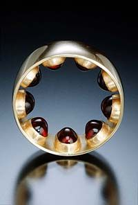 Nick Dong Ring featuring bullet cut garnets(?) on the INSIDE of the ring. What a clever way to create such a ring!