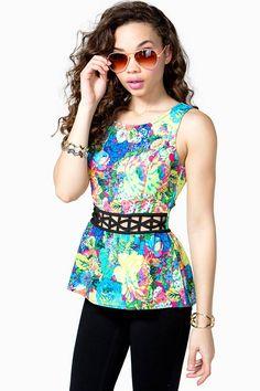 A fluorescent floral top featuring a peplum waist and a cutout at waist. Round neck. Sleeveless. Zip closure at back. BOUTIQUE FIVE.