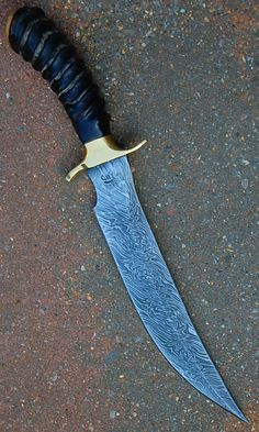 Persian Bowie blade of forged in fire damascus n brass guard and pommel , handle in oryx horn knife www.