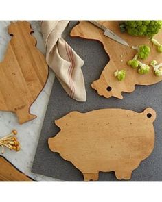 Animal Wood Cutting Board: Make a statement with these novelty animal shaped cutting boards. Each board is finished with a brightly colored milk paint edge that makes the perfect surface for a selection of cheeses or appetizers. Distressed maple design adds a beautiful artisan touch to any kitchen.