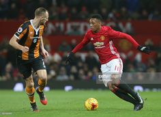Anthony Martial of Manchester United in action with David Meyler of Hull City during the EFL Cup Semi-FInal first leg match between Manchester United and Hull City at Old Trafford on January 10, 2017 in Manchester, England.