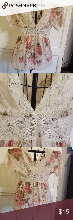 Sheer lace printed blouse So beautiful LACE top has an empire waist with three buttons and printed roses on the bodice I've had this in my closet closet over a year and I've been waiting for it to fit me but it's been there too long taking up Space. It's time to share with someone else. Tops Blouses