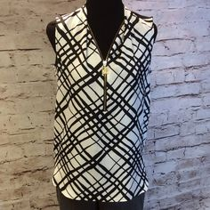 GORGEOUS BLOUSE BY ANNE KLEIN This is a very classy yet comfortable blouse with a fabulous print and zip neckline. Front is a polyester and back is a stretchy knit. Use it layer or wear alone with slacks or a skirt for all year use. T-1 Anne Klein Tops Blouses