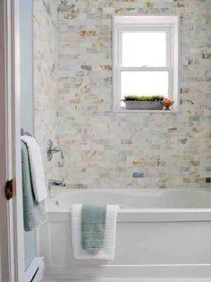 Potted Grass | Shower Tub | Blue Wall Color | Paint Color | Tile Backsplash | Bath Design Ideas | Mosaic Tile