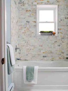 A #natural stone #tile look for the #bathtub #shower.