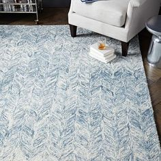 Vines Wool Rug - Blue Lagoon #westelm...  Could this be a transitional pattern that compliments your chairs... Not quite right, but getting closer?