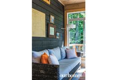 """In the sunroom, stained exterior siding was applied to the walls to create an outdoor ambience. Reminders of earlier generations inhabit the cottage. On the wall is the owner's father's fishing map showing local lakes, encircled with different colours representing the species of fish that he caught.   See more of this home in """"Cottage Blends Memories with Eclectic Styling"""" from OUR HOMES Muskoka Fall 2016…"""