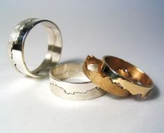 The join of the wedding ring is created from a stretch of coastline you choose yourself, making your ring unique. so neat!