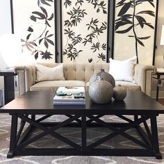 Alice Lane Home Collection    Black and white living room setting with large art.