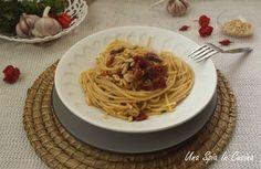 Spaghetti aglio e olio con pomodori secchi e colatura
