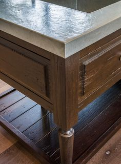 Kitchen island hammered zinc countertop, fumed oak cabinets in a distressed finish.  Past Basket Design.