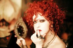 Cyndi Lauper's stylist Nikki Fontanella says hair and makeup help keep the new blues-homage look modern. Description from blogs.sun-sentinel.com. I searched for this on bing.com/images