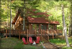 Sweet little cabin ~ love the wrap around porch and the windows