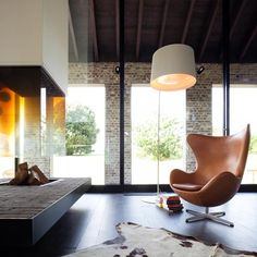 Arne Jacobsen's Egg chair in front of a large open fire