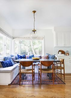 """Love the storage corner seating around the table. Build a """"wall"""" of open storage to back by the door, shoe cubbies by floor, dog leashes etc  higher.."""