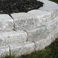 Staggered rows of pavers adds strength to raised bed walls. Staggered rows of pavers adds strength to raised bed walls. Staggered rows of pavers adds strength to raised bed walls. Backyard Retaining Walls, Building A Retaining Wall, Garden Pavers, Patio Pergola, Building A Raised Garden, Garden Edging, Raised Garden Beds, Raised Patio, Garden Ideas With Pavers