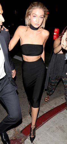 Gigi Hadid wears the black choker trend with a trendy midi-skirt.