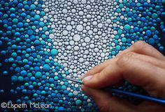 Artist at work- Elspeth McLean creating one of her original dot paintings with a fine 00 sable brush. LOVE this kind of art... I'll have to try it myself!