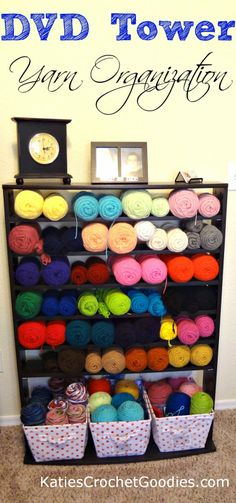 PRACTICAL and BEAUTIFUL!! Genius...organize yarn using a DVD tower --would love to have this much yarn!