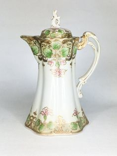 Lovely ornate antique Nippon China Chocolate Pot or Teapot trimmed in gold. Hand Painted pink flowers with generous gold trim. Porcelain Dinnerware, Porcelain Ceramics, Painted Porcelain, Fine Porcelain, China Teapot, Tea Pot Set, Pot Sets, China Tea Sets, Japanese Porcelain
