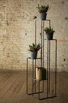 Elevate plants or decorative objects with this awesome set of four iron pedestals in staggered heights.