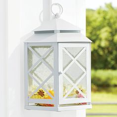 Lattice Mirrored Lantern Garden-inspired latticework lends our lantern summertime charm! Place two lanterns back-to-back for a unique hexagon shape. Metal; weather-resistant finish. Bubble glass panels with a mirrored interior enhance the reflection of candlelight.