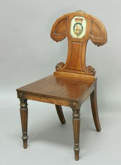 Attractive Nineteenth Century Mahogany Hall Chair. Shield Shaped Back With  Carved Scroll Decoration, The Seat Raised On Turned Reeded Legs. Circa.