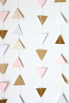 Blush pink, white and shimmery gold paper triangle garland - SO fun for a variety of events! Baby Shower Gender Reveal Birthday Party Wedding Bridal Shower Nursery Decor Home Decor Crib Mobile And so much more! this listing includes: 12 feet of garland, your choice of colors. Cardstock triangles are 1 each. Colors featured above: Gold Shimmer Blush Pink White Gold Glitter Not the size you need? Please contact me, I am more than happy to make a custom garland for your event or home. C...