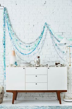 DIY Winter Garland | @westelm + @designlovefest (punch out or cut paper or cloth circles and sew them together to make chains...)