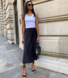 7 Things That Make a Basic Tank Look Exceptionally Cool Vogue Fashion, Girl Fashion, Fashion Ideas, Plain Tank Tops, Summer Outfits, Casual Outfits, Satin Midi Skirt, Slip Skirts, Midi Skirts