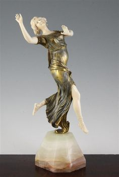 Henri Fugere, (French,1872-1944). An Art Deco bronze and ivory figure of a dancer