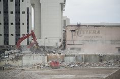 Workers continued demolition operations at the shuttered Riviera on Friday, making progress toward the scheduled demolition of the towers in June and August.
