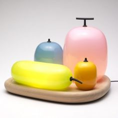 Fruits Table Lamp  by Hisakazu Shimizu. If you go to his site, there is also a cool fruits wall lamp.
