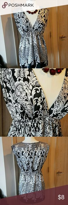 Patterned deep v-neck blouse Patterned deep v-neck blouse. Black and white print. Lightly worn, no snags, or holes. Polyester. Animal and smoke free home. Tops Blouses