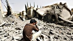 A Yesits on the rubble of a house after air strikes destroyed it in Sanaa, Yemen, on Monday