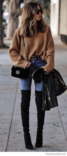 Brown sweater, blue jeans and black details