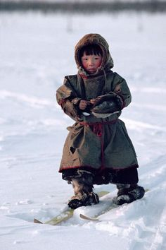 Nenets boys learn to ski almost as soon as they can walk. Yamal. Siberia. Russia.