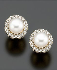 A simply glamorous addition to any look. 10k gold earrings featuring cultured freshwater pearl (4mm) and diamond accents.   Photo may have been enlarged and/or enhanced.   This item cannot be shipped
