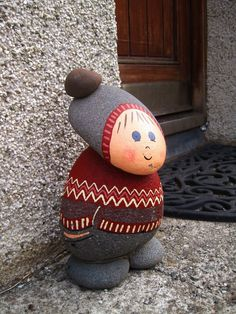 Cutest doorstop gnome Completely Icelandic, down to the traditional patterning of the Icelandic woolen jumper and volcanic rock. They didn't have any banker gnomes getting put into gnome jail though. Stone Crafts, Rock Crafts, Fun Crafts, Arts And Crafts, Pebble Painting, Pebble Art, Stone Painting, Painting Art, Rock Painting Designs