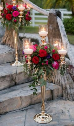 Elegant Inspired Southern Wedding Outdoor Reception Decor with Tall Candelabra with Hurricane Lanterns, Red Roses and Purple and Magenta Flowers with Greenery | Tampa Wedding Florist Northside Florist
