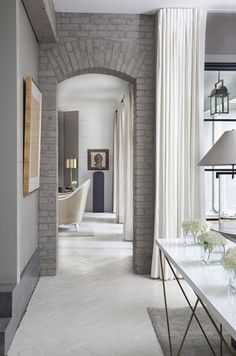 gray brick walls set against white painted floor, traditional lines with scandinavian modern color scheme