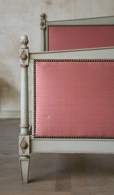 Vintage Pink Satin Upholstered Bed. if i ever find the perfect old bed frame i could easily do this myself. some plywood, batting, fabric, and rivets