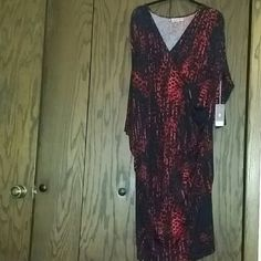 NWT Jennifer Lopez dress Red and black leopard faux wrap dress. Sleeves are 3/4 length. Overall length is just below the knees. Jennifer Lopez Dresses