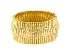 An 18 karat yellow gold French wide bangle with 30 round brilliant diamonds totaling approximately 6 carats. Available for purchase online at www.leonardojewelers.com and in our Red Bank, NJ and Elizabeth, NJ stores.